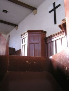 View of stark wooden pulpit