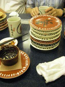 Pile of used Sushi plates
