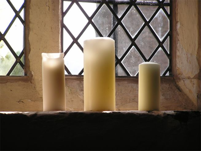 Candles on windowsill at Garway church