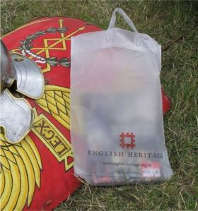English Heritage carrier bag resting on Legionary shield