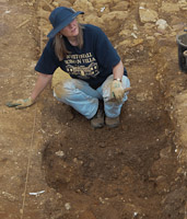 Ruth in trench with trowel