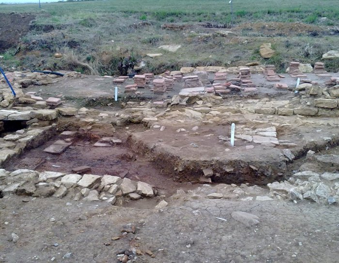 Remains of walls and underfloor heating for bath house