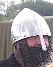 Man in chainmail and silver helmet with nose protector