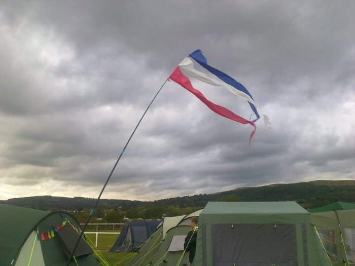 Picture of red white and blue pennants flying over tents