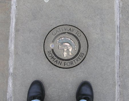 Marker in pavement showing position of Roman gateway