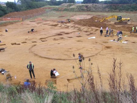 Wide shot of cleared excavation area