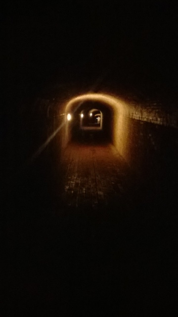 Long dimly-lit brick tunnel