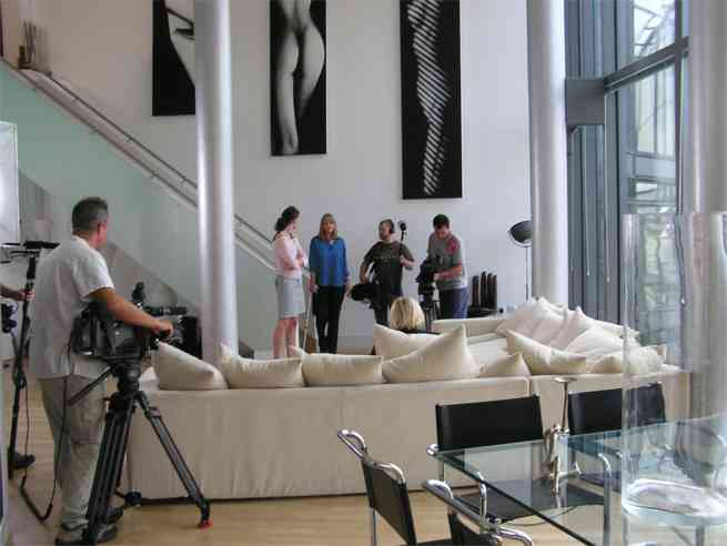 Setting up for filming at the foot of stairs.