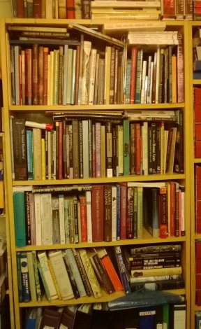 Shelves crowded with books about Romans and Ancient Britain