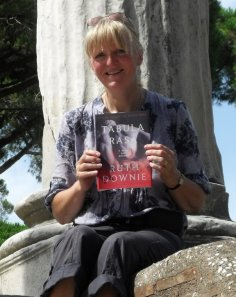 Ruth holding copy of Tabula Rasa in Ostia