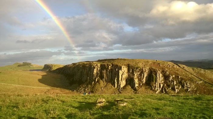 Rainbow over cliffs at Hadrians Wall