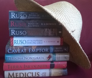 Books available to win in the draw, shown under a hat.