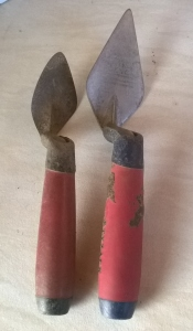 Two trowels, one worn down to half-size.