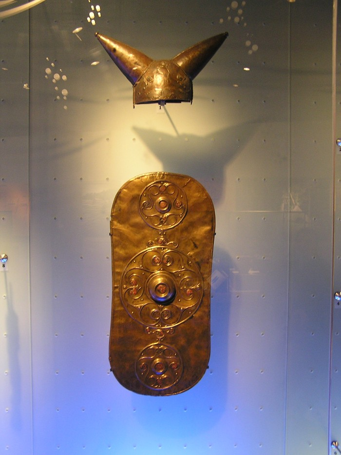 Bronze horned helmet and ornate bronze shield cover