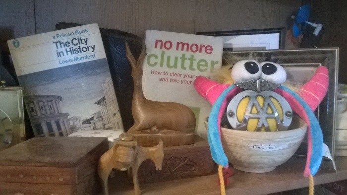 View of clutter including a book called NO MORE CLUTTER