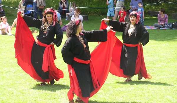 Traditional Arabic dancers with red skirts