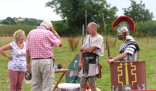 Roman soldiers talk to visitors