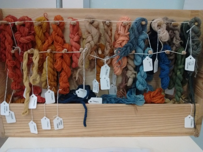 Skeins of wool dyed with natural materials
