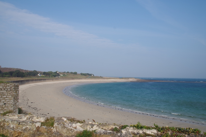 Sandy bay with blue sea and sky
