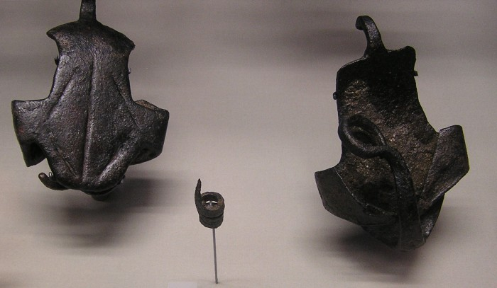 Two metal hipposandals and a spiky ox goad