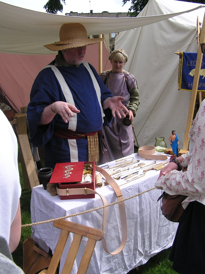 Man explaining display of medical instruments