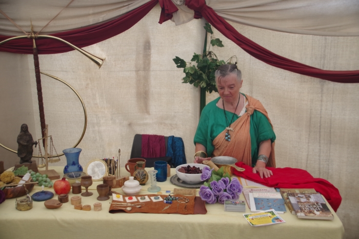 Lady with display of Roman goods