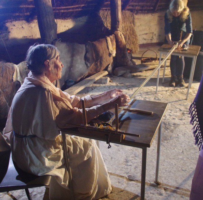 Two women weaving braid