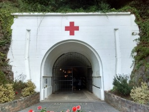 Entrance to tunnel with red cross painted above it