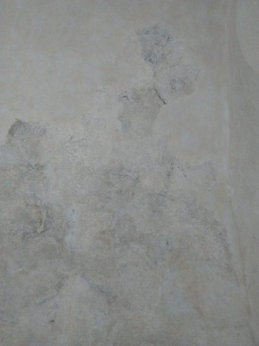 Old white limewashed wall of chapel