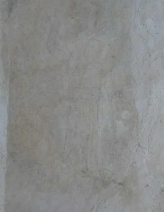 Wall with faint angel painted on it