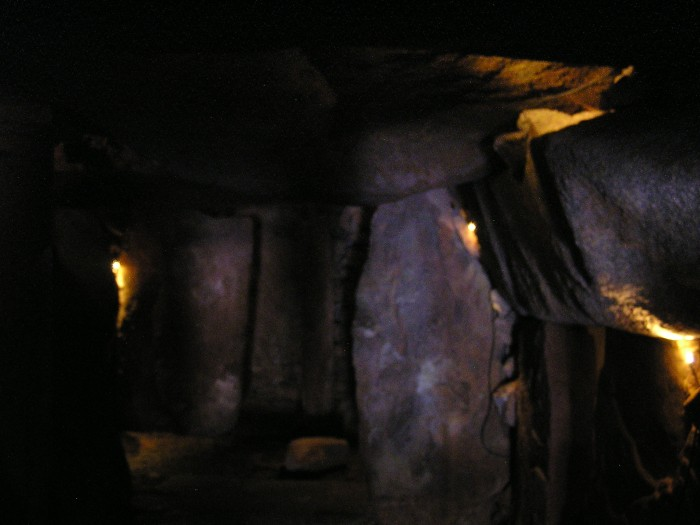 Very dark cavern built of huge stones
