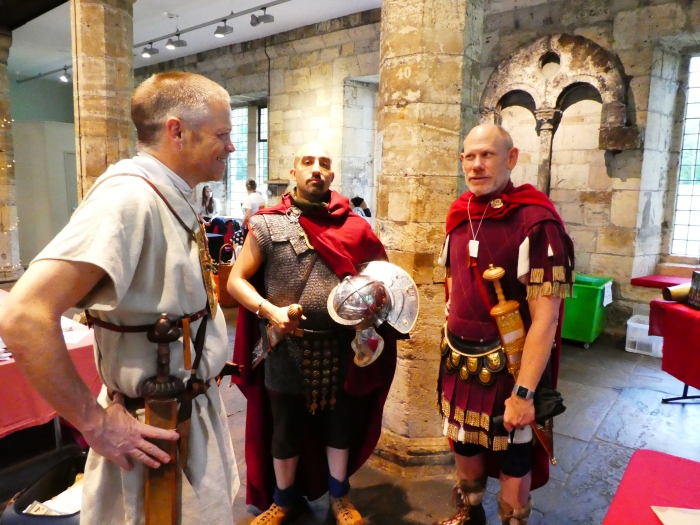 Three men in Roman military outfits