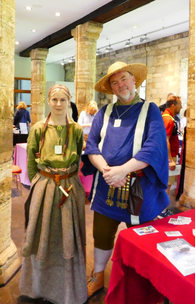 Man and a woman in Roman and British costumes