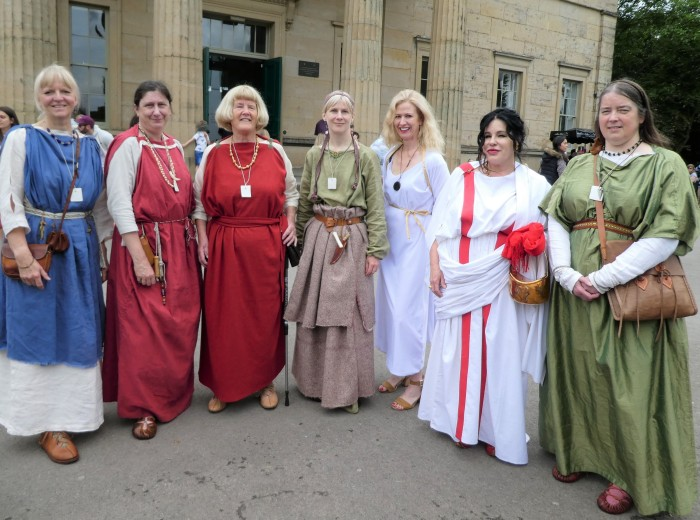 Six women in Roman or Ancient British clothing