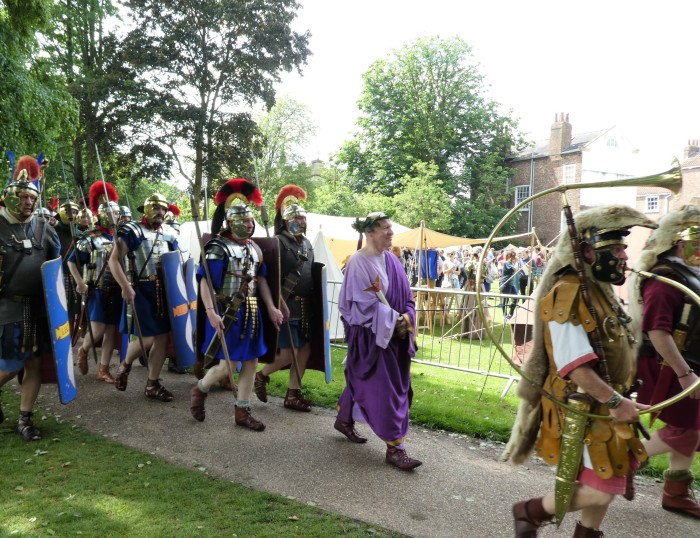 Emperor in purple robes escorted by Roman troops