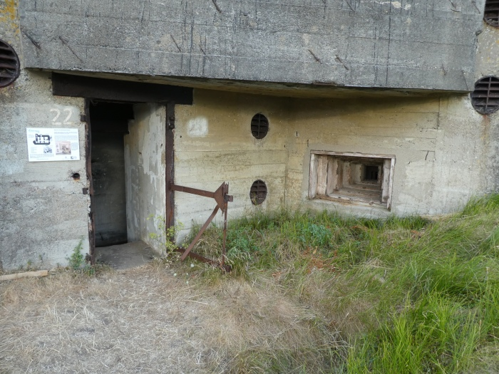 Concrete bunker with ruined door