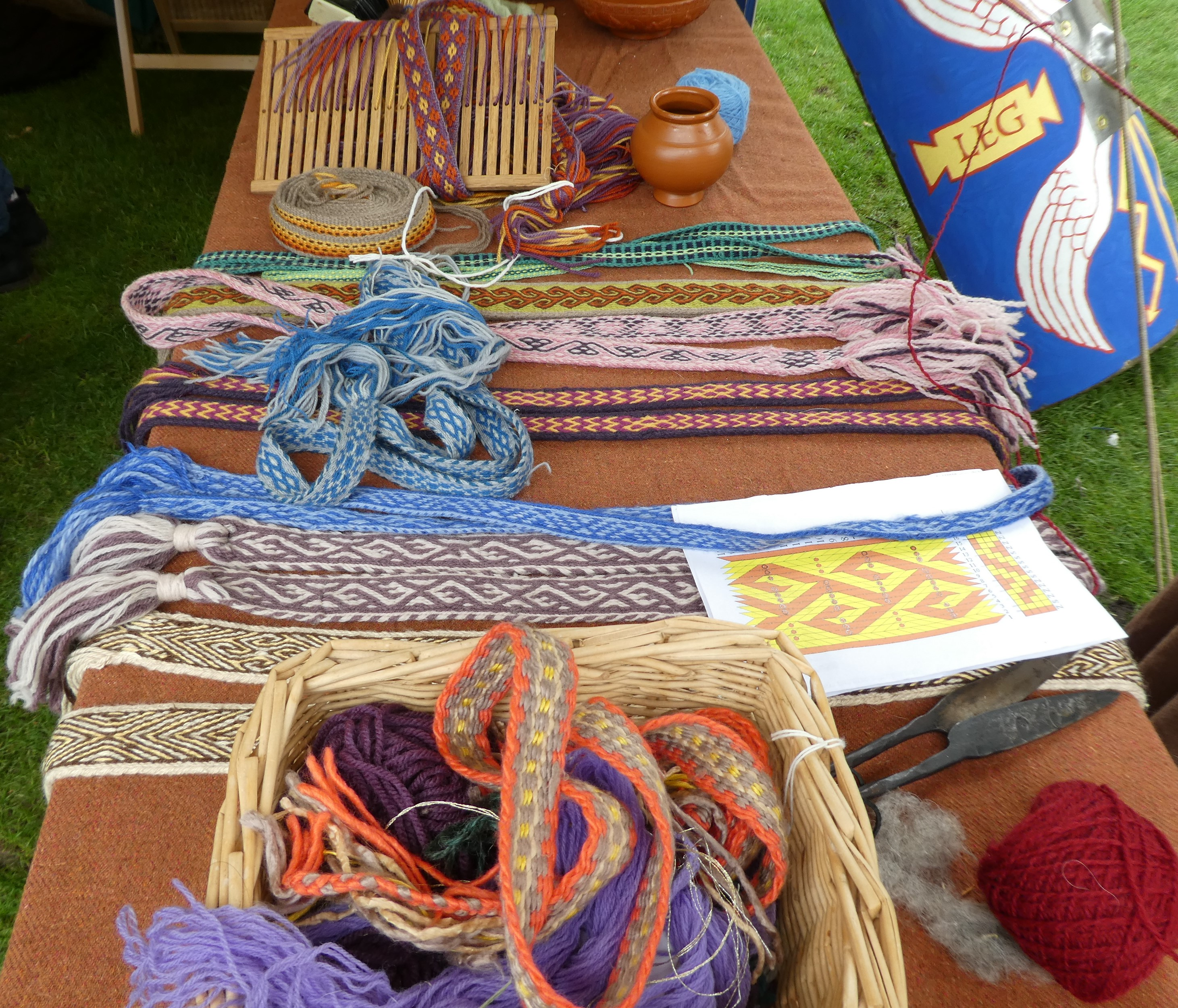 Display of brightly-coloured, patterned wool braids.
