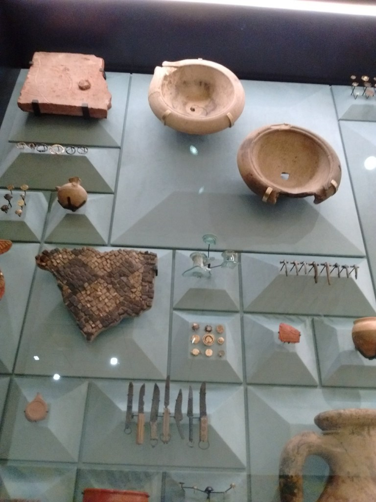 Part of display case full of finds from the London Mithraeum